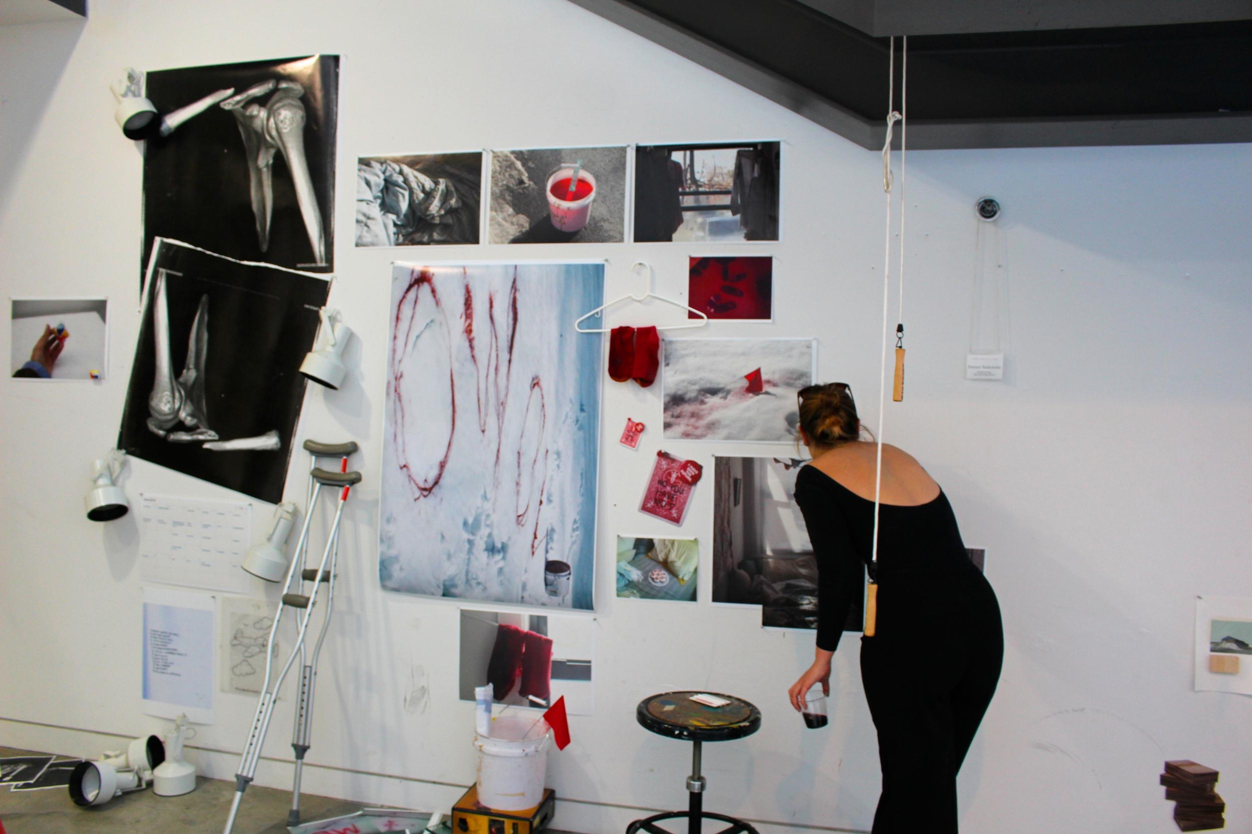 Emma Sadowski '15 adjusts her installation