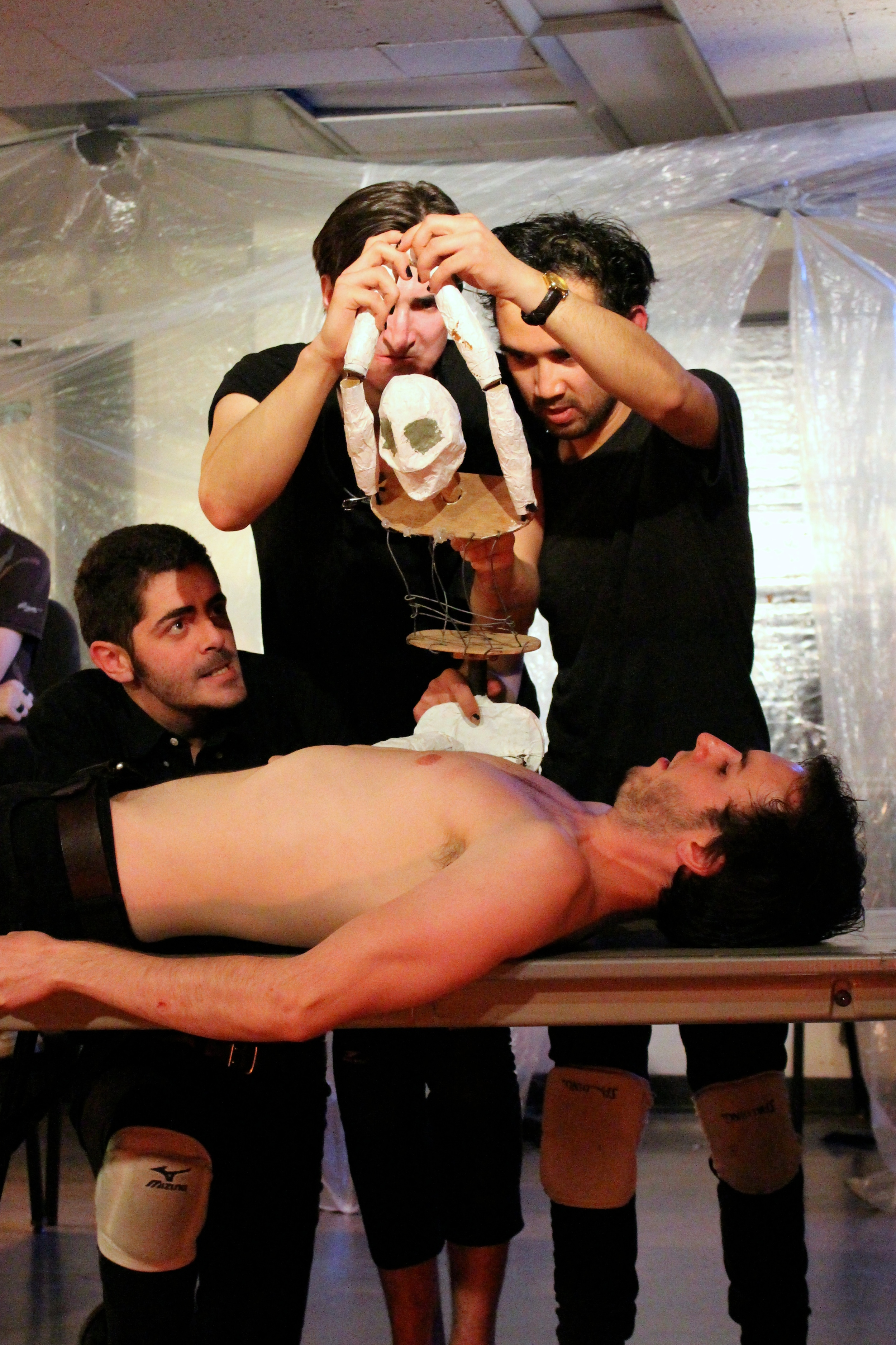 Shylock prepares to remove a pound of flesh from Antonio's chest