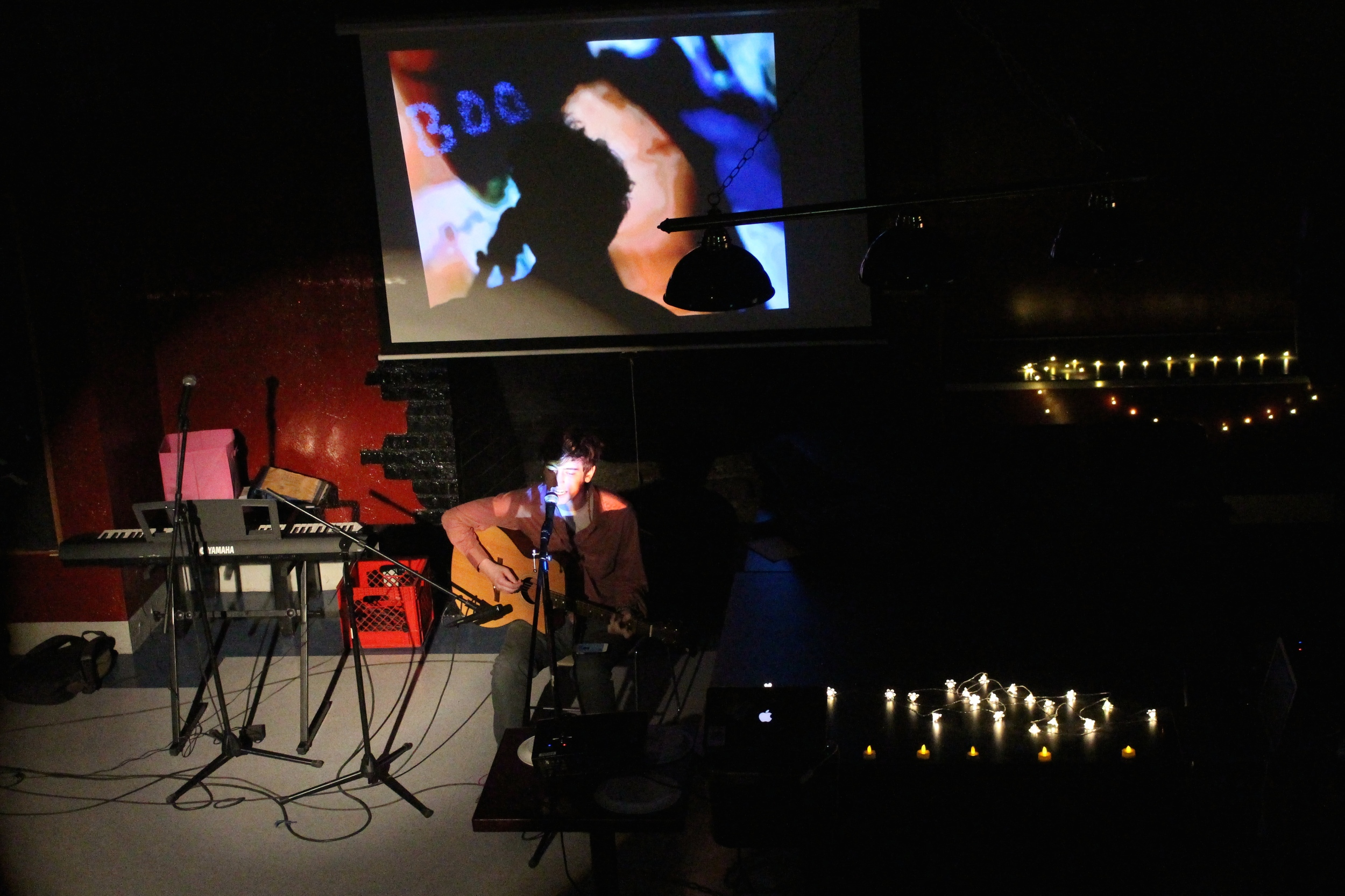 Nate Phillips '17 played an original song as a video installation ran in the background
