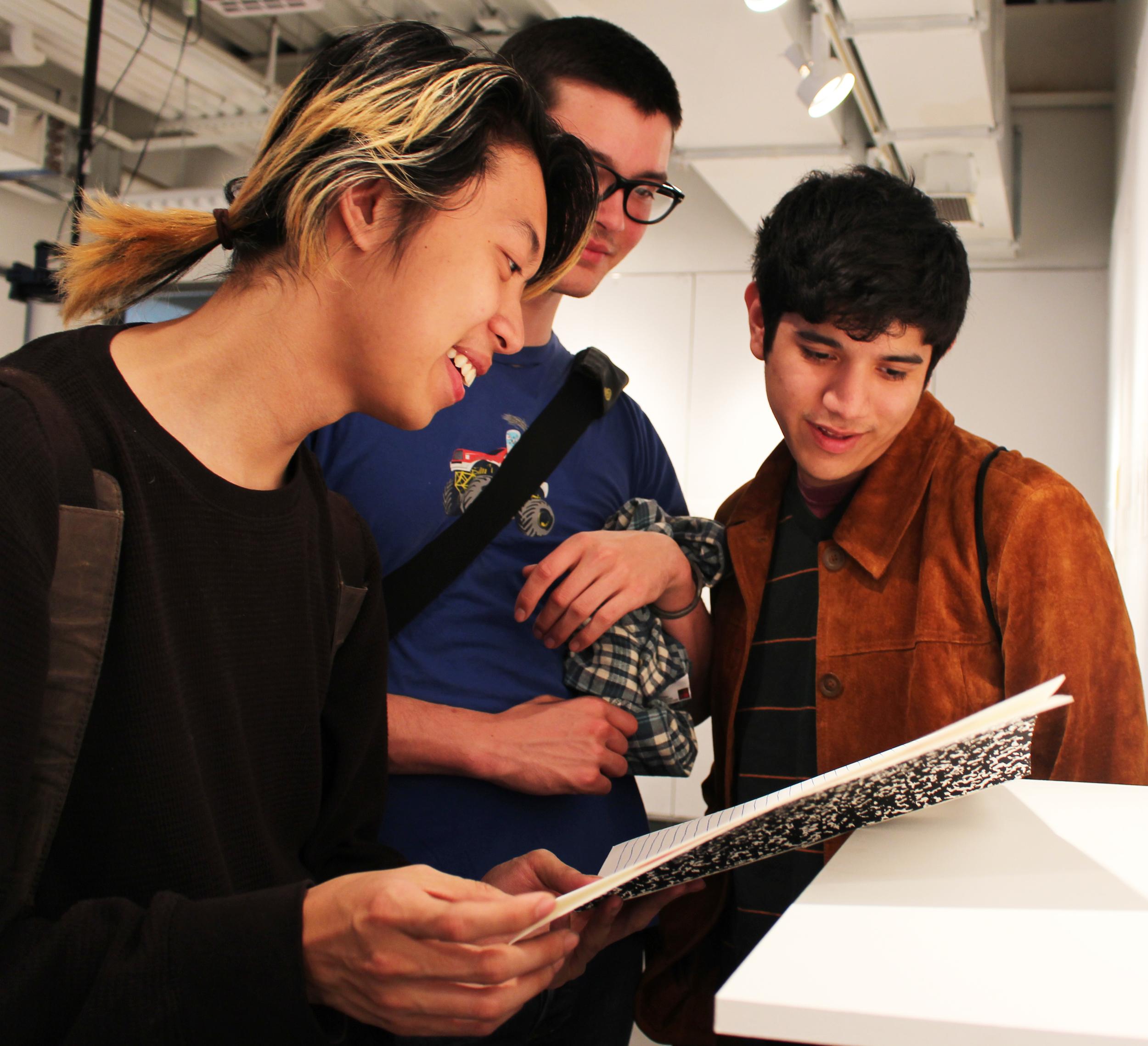 Tuyên Nguyễn '17, Jericho Walter-Roberts '17, and Kurt Santana '16 view student work