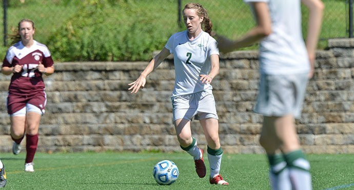 Sadie Zavgren '17 looks for an open teammate to pass to  Photo by Paul Blascovich