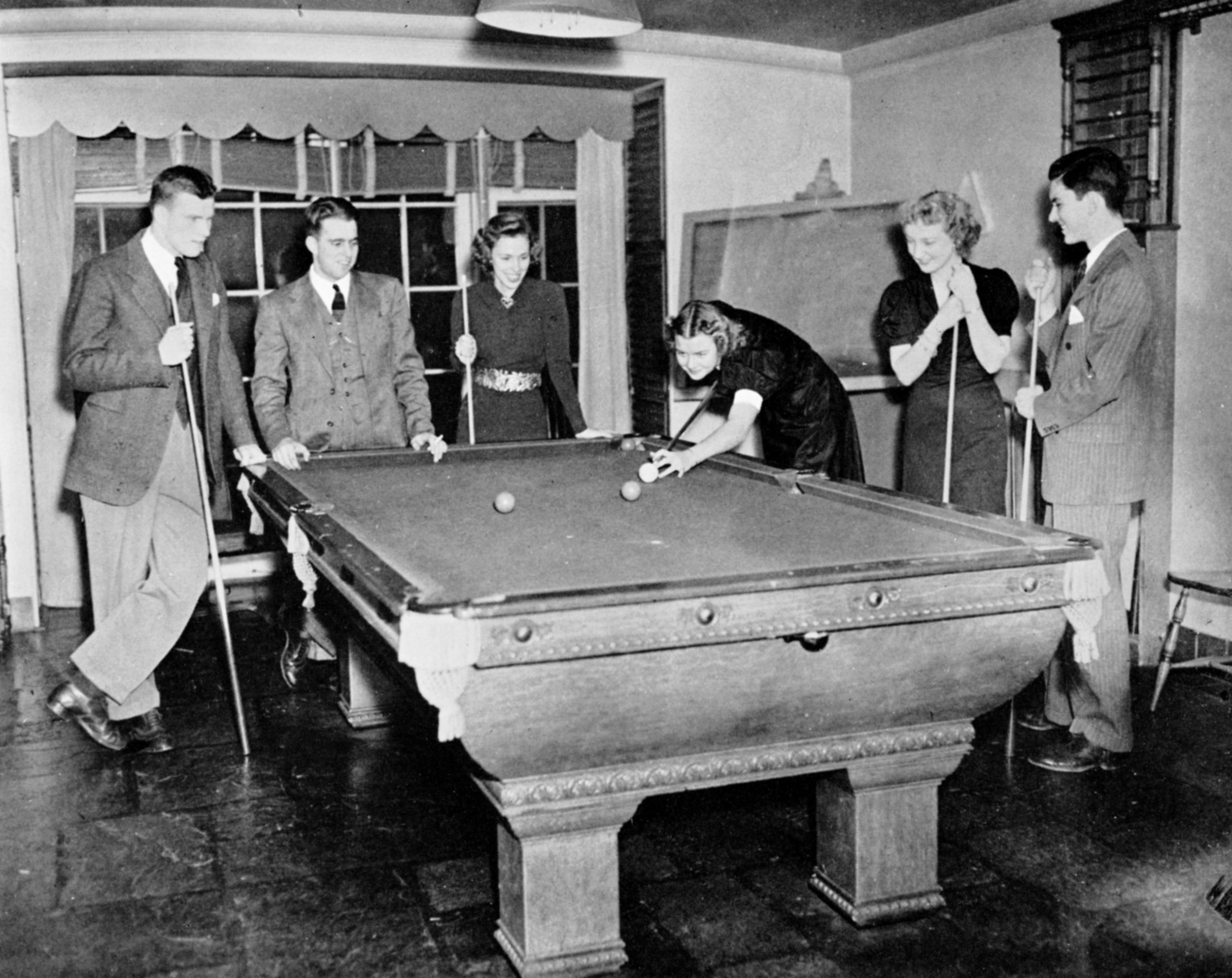 "Sarah Lawrence women Marjorie Rile '41, Dorothy ""Dot"" Hodge '41, and Jo Hill '41 play pool with their dates during a Sunday tea dance in 1938 . Photo courtesy Sarah Lawrence College Archives from the 1938-39 SLC Yearbook."
