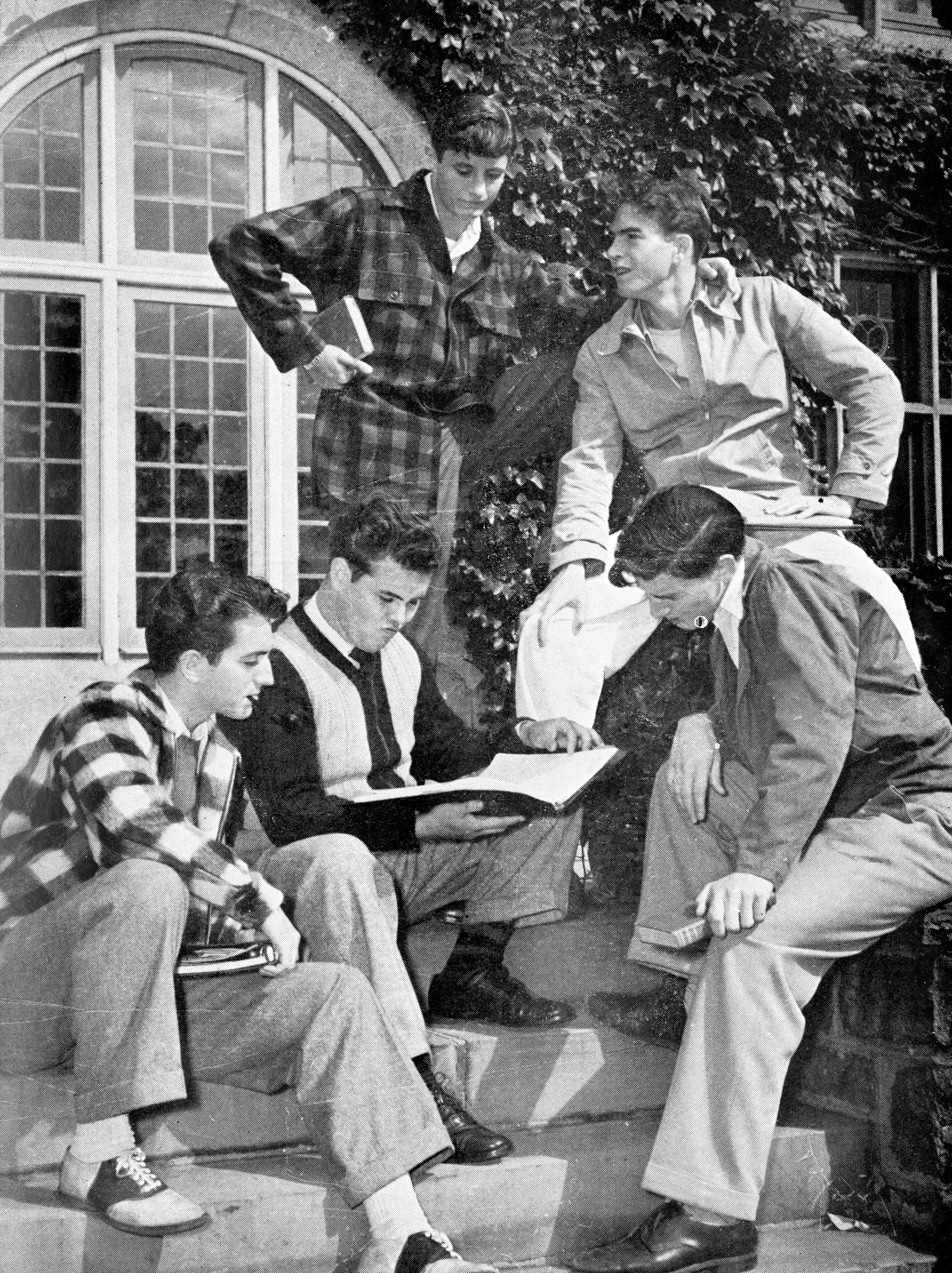 Veterans permitted to attend SLC prior to the college's decision to go co-ed contemplate course offerings  on the steps of Westlands in 1946. Photo courtesy Sarah Lawrence College Archives from the Sarah Lawrence Alumnae/i Magazine.