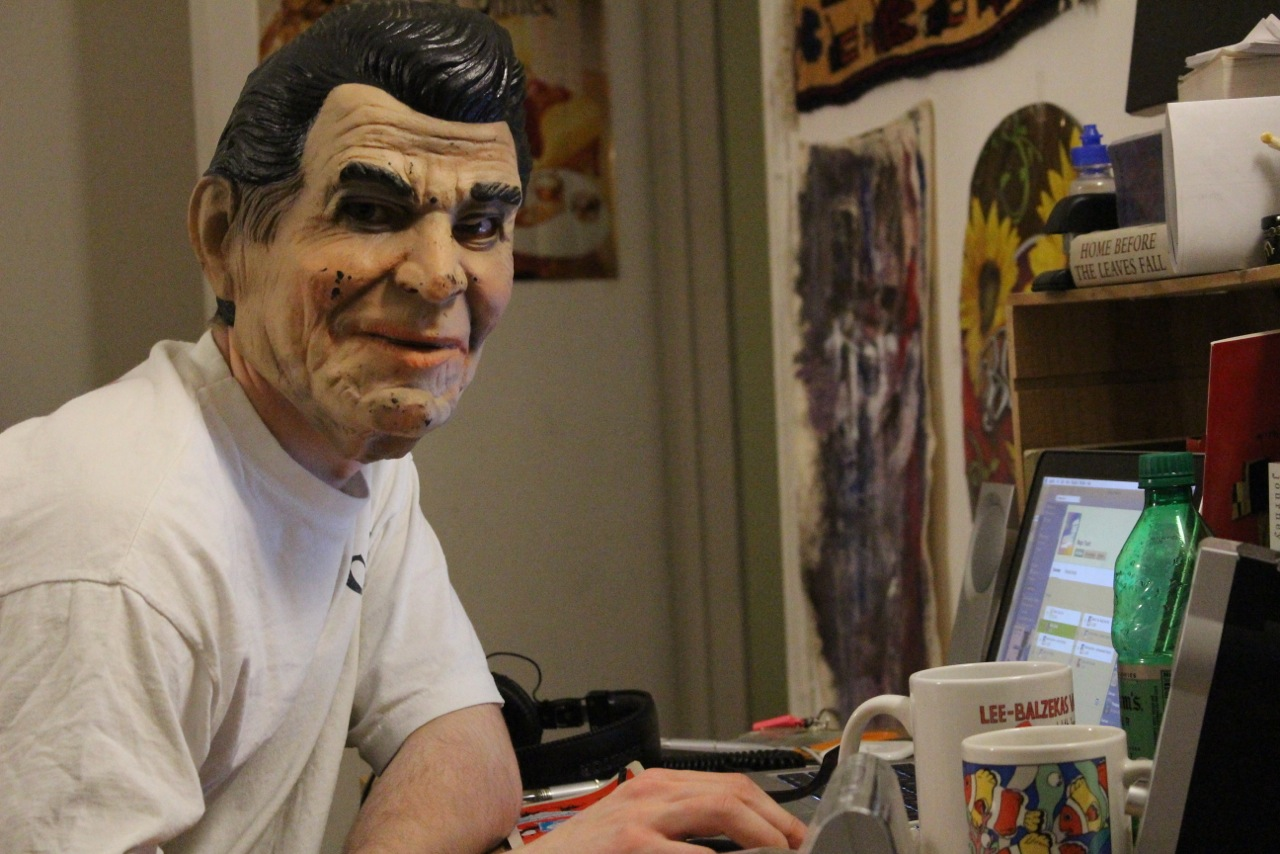 Vasaris Balzekas '17 poses behind a Ronald Reagan mask. Photo courtesy Ellie Brumbaum '17.