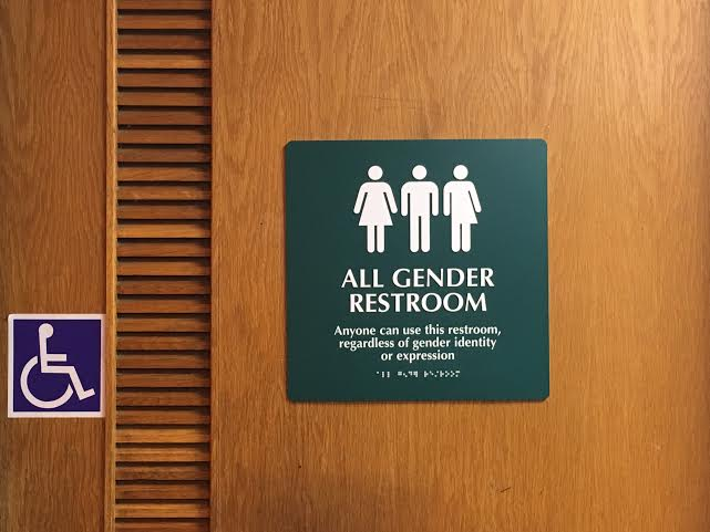 All gender bathroom signage in Esther Raushenbush Library's downstairs restrooms. Photo credit: Andrea Cantor