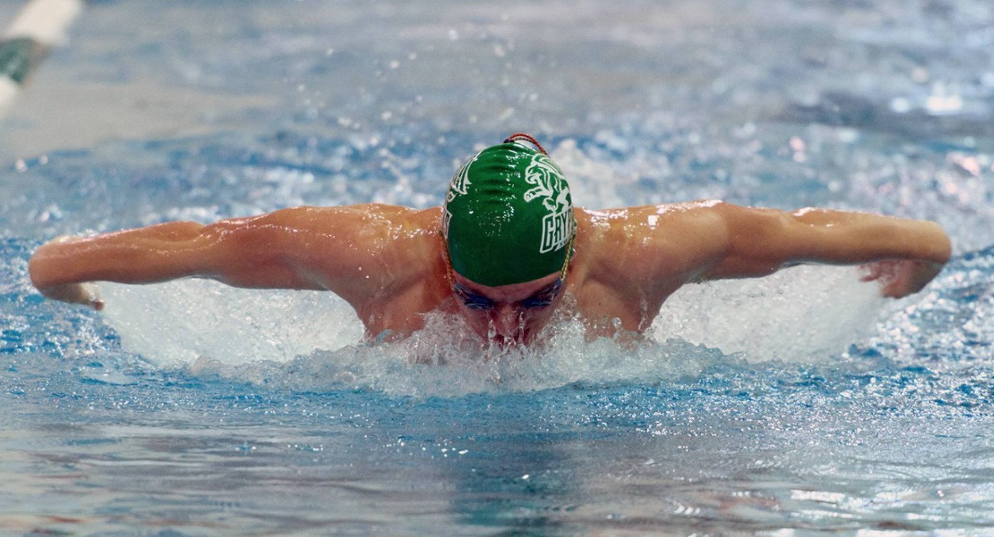 LAWSON TAKES A BREATH WHILE SWIMMING THE 200 MEDLEY AT A MEET   PHOTO BY TONY CORREA