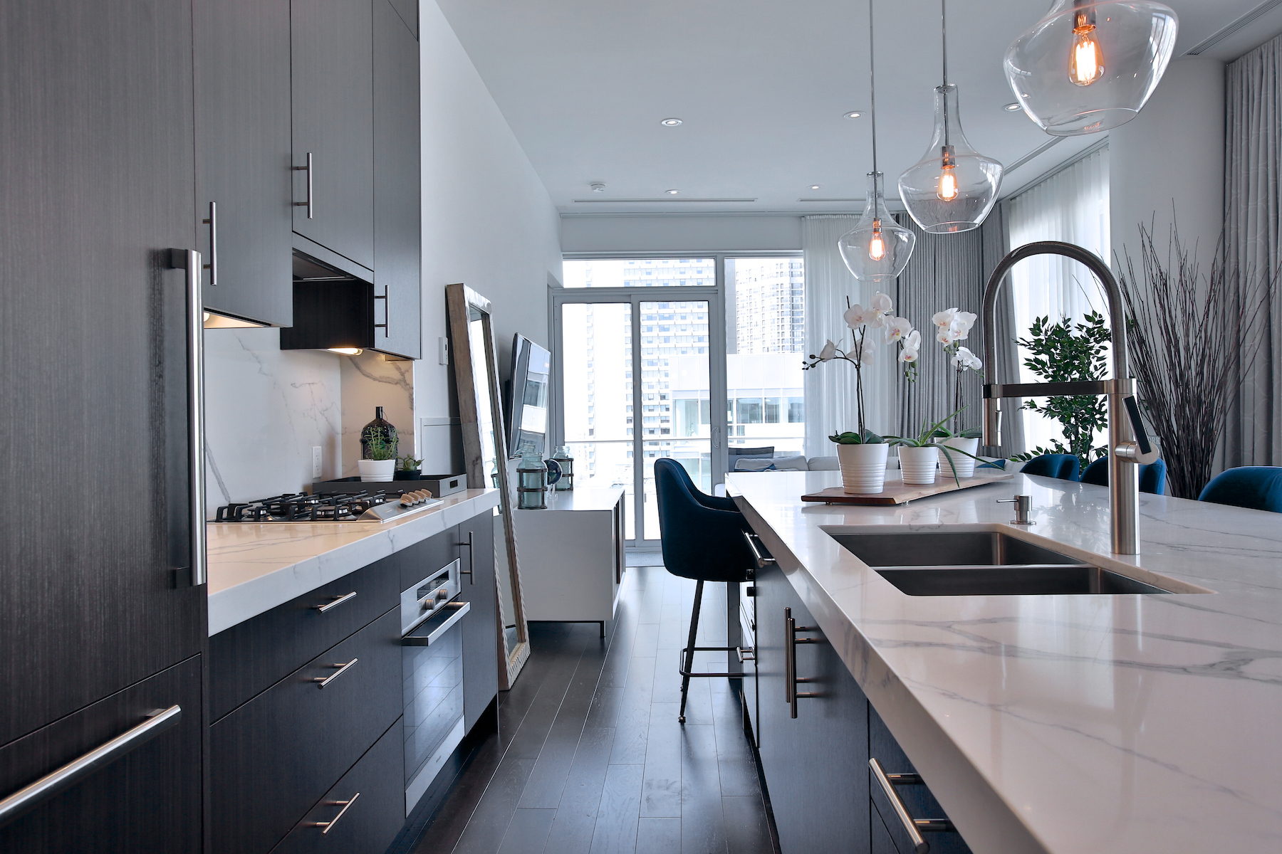 Refinished kitchen with upgraded custom island for entertaining in casual elegance or romantic gourmet meals with your loved one. Cabinets built with smart and ample storage designed for condo living without compromise.