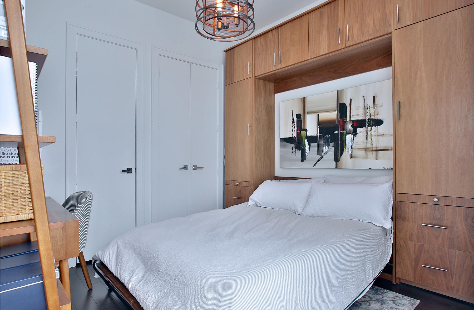 Bedroom with built in Murphy bed doubles the usable space in this room.