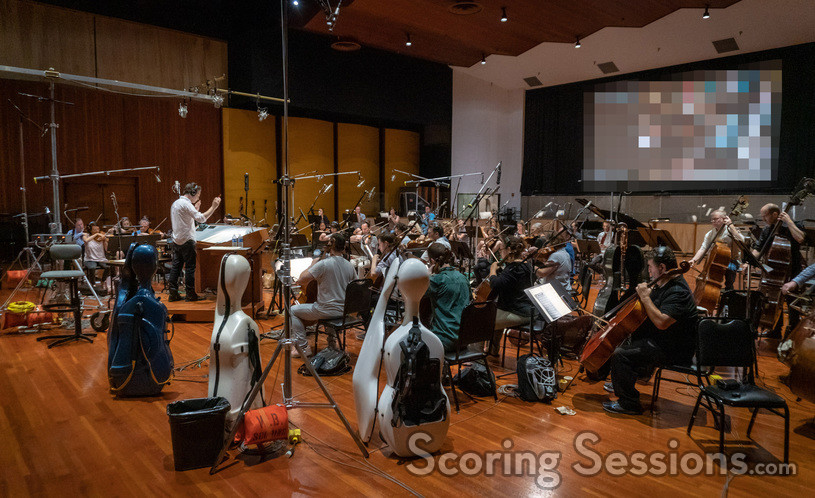 Composer  Jeff Russo conducting the orchestra.