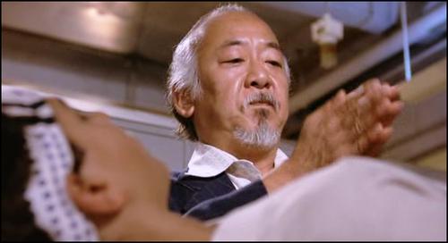 Pat Morita. Be honest, does the  Miyagi-hand-clap  still give you chills?