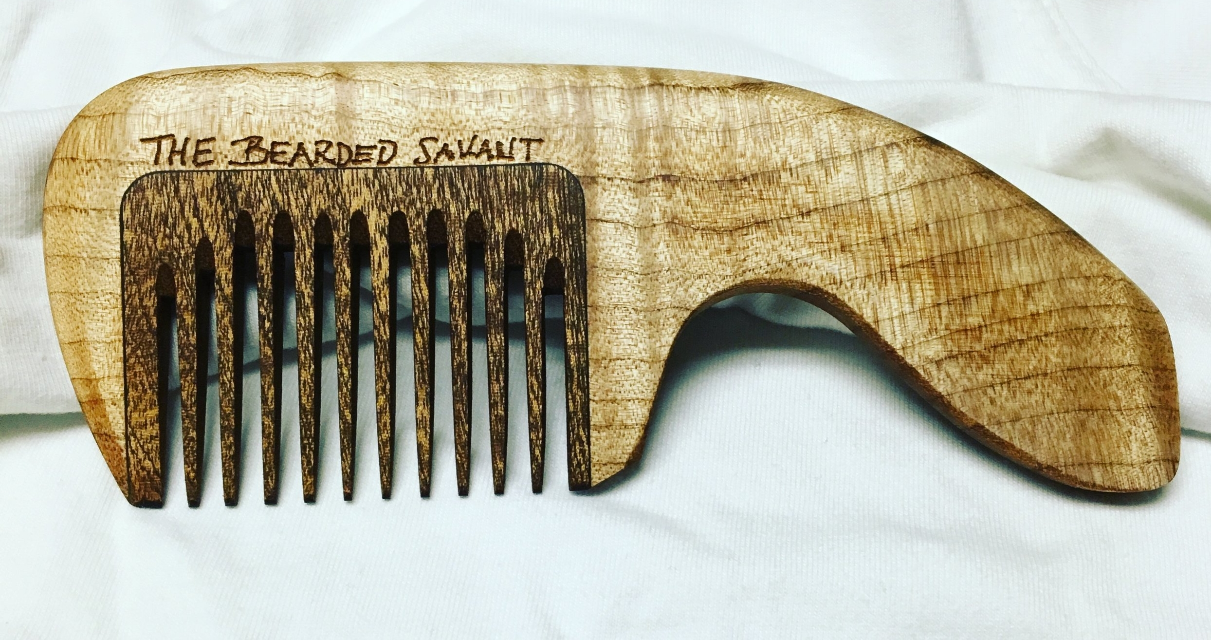 Tiger maple inlaid with sapele. Note the direction of the grain: along the long axis in the handle and along the teeth in the inlay, this provides provides maximum strength in the direction of greatest stress.
