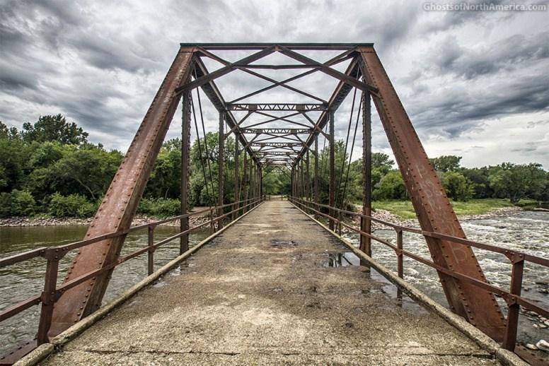 The old  Klondike Bridge spans Big Sioux River between South Dakota & Iowa