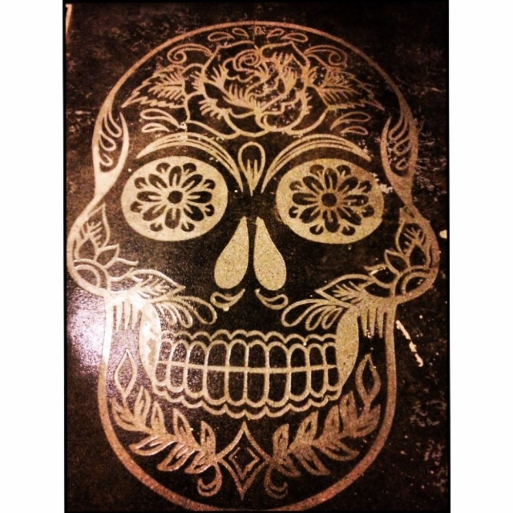 Mexican, Day of the Dead concrete engraving.