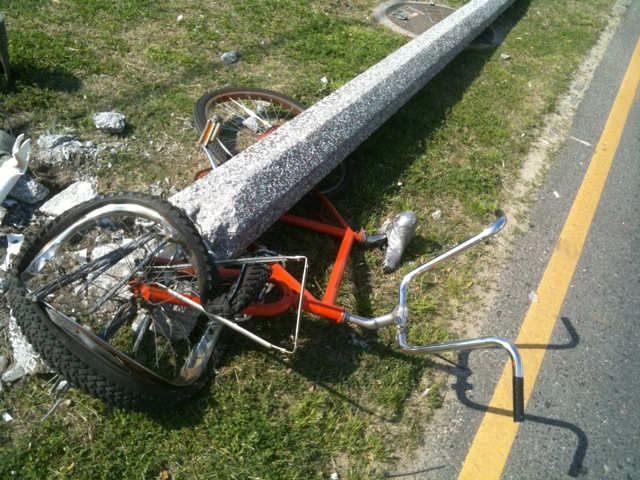 I found this bike crushed by a streetlight post it had been locked to, which had fallen over in the night.