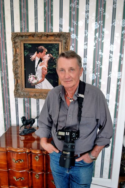 This is a portrait I took of Jerry in Floyd, VA. The photo behind him was one of his favorite wedding photographs.