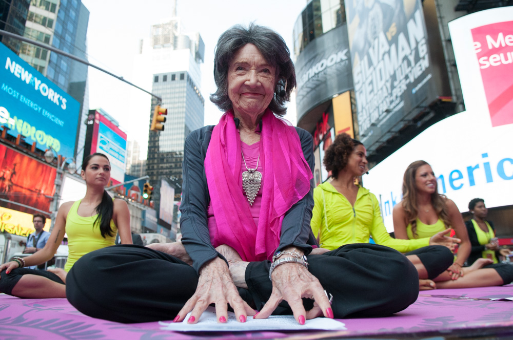 94 year old yogi Tao Porchon-Lynch led the morning meditation to kick off the Solstice in Times Square event