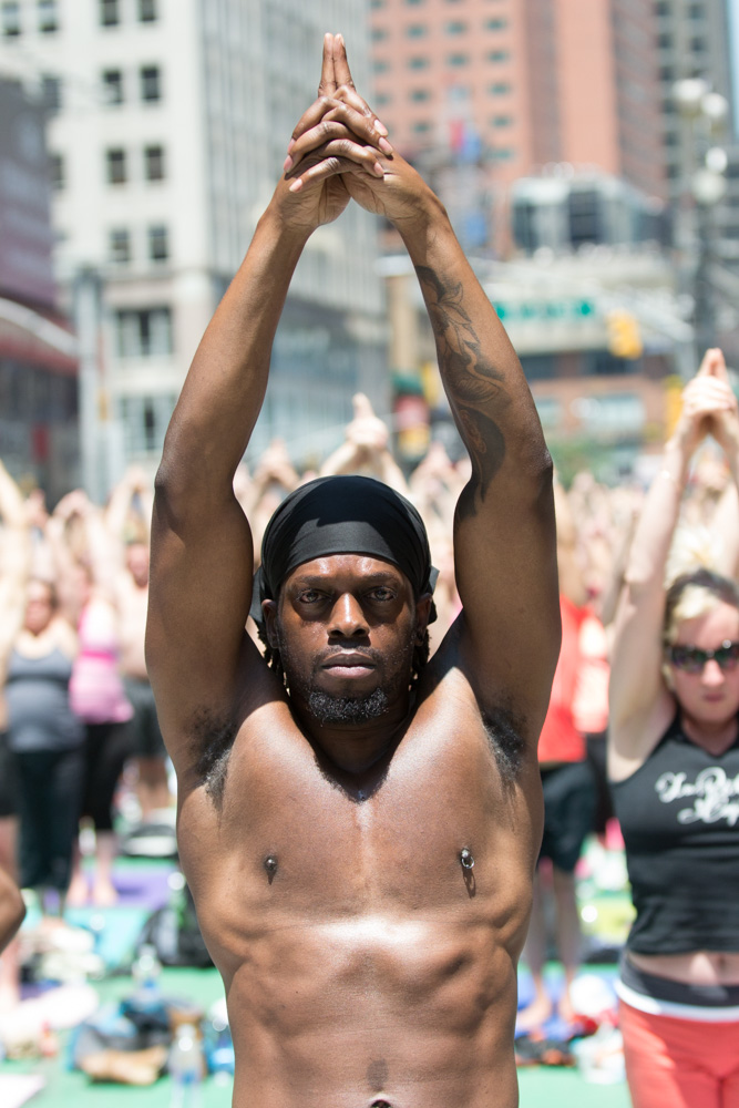 An intense look from a yogi performing Urdhva Hastasana (upward salute)