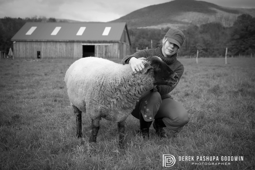 Megan with a sheep at Woodstock Sanctuary