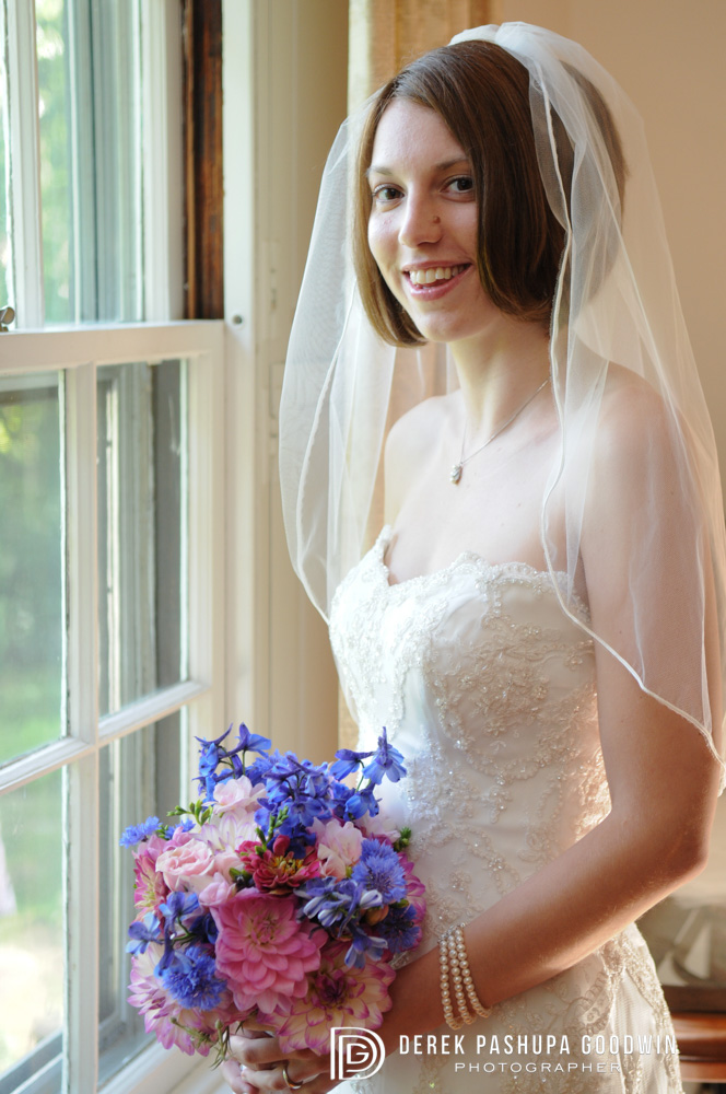 Christina in her wedding dress with bridal bouquet
