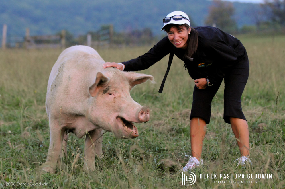 Hilda Club member with pig at Farm Sanctuary Hoe Down