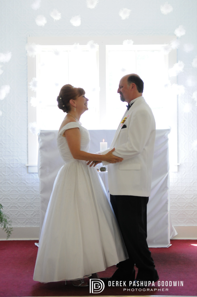 The bride and groom share a moment at the altar