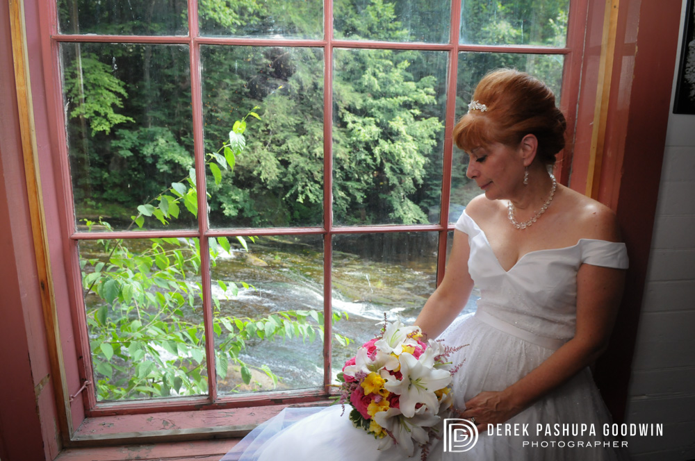 Portrait of the bride in Montague Bookmill overlooking the river