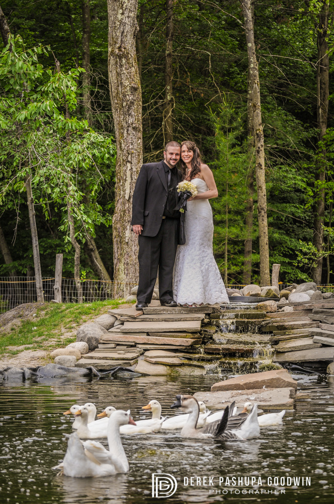 bride and groom by duck pond