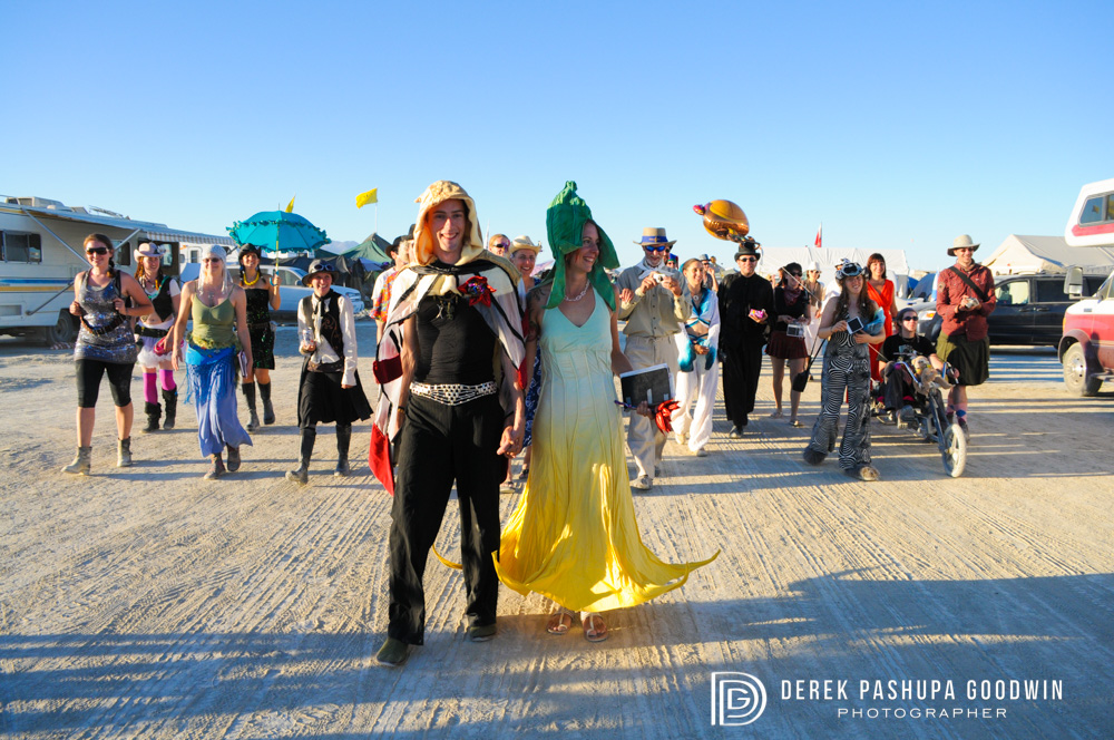 bride and groom lead procession on the playa
