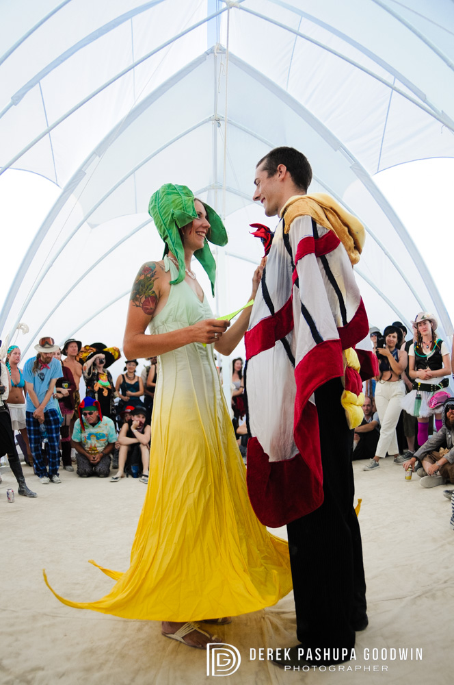 bride and groom exchange vows at burning man
