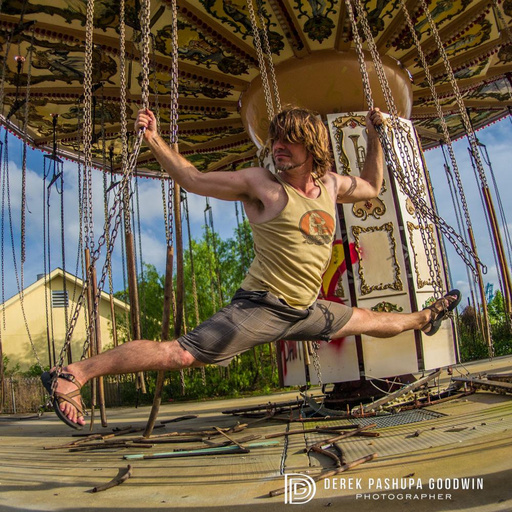 #5 Monkey Pose (Hanumanasana) - This photo is of me at the abandoned Six Flags in New Orleans, that was destroyed by Hurricane Katrina. Usually hanumanasana is done on the ground, but in tribute to Hanuman, who performs this pose as he jumps over the ocean to find Sita, I am doing it in the air!