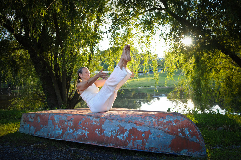 Navasana | Boat Pose - As a lover of visual puns, I couldn't help but ask Jivamukti yogi Julie Kirkpatrick to bust out a Navasana when we saw this row boat at the Catskill Animal Sanctuary. I would say she nailed it!In her article 7 Yoga Poses for Surfers of All Levels, yogi Florence Shihwrites about Navasana,