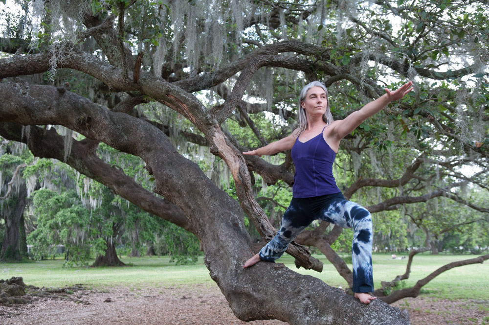 Virabhadrasana II | Warrior 2 - I captured this photo of yogi Cat McCarthy practicing Virabhadrasana II at the Tree of Life in New Orleans' Audubon Park.In the blog post 10 Best Yoga Poses for Surfers, Jack Albritton writes,