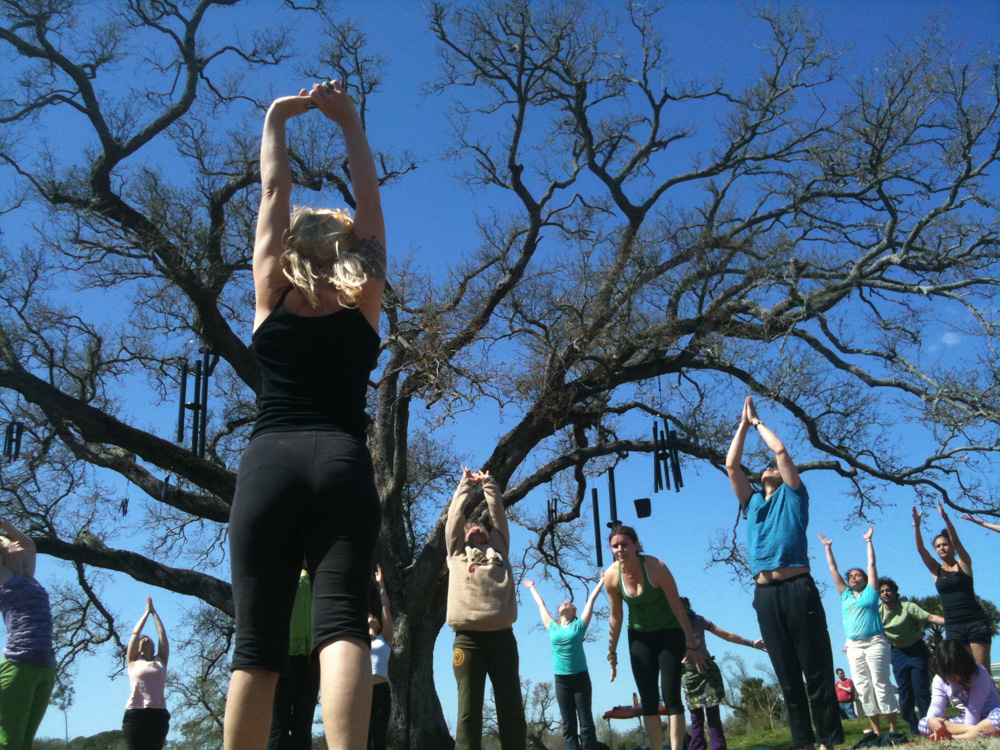 Michelle Baker leads 108 sun salutations