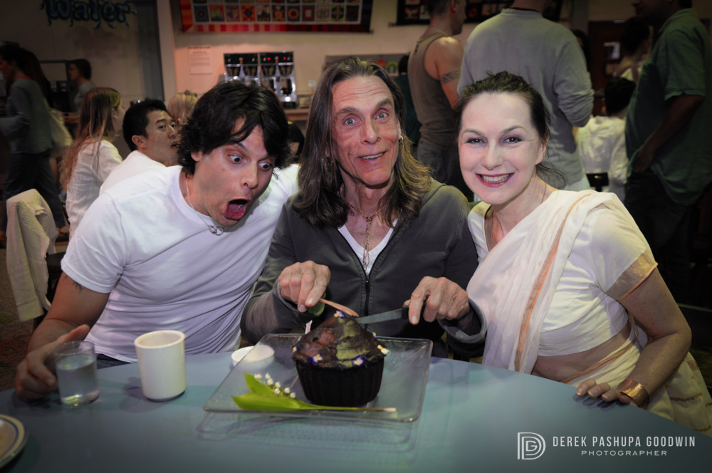 Jeffrey Cohen, David Life and Sharon Gannon share a giant vegan cupcake