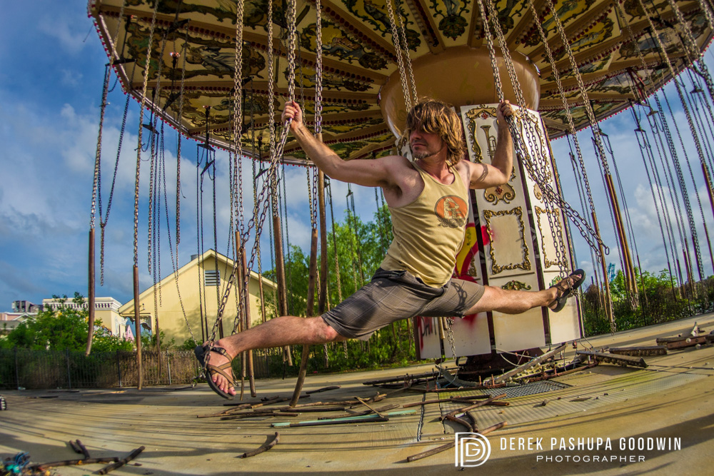 """Hanumanasana  (monkey pose) on dilapidated ride in New Orleans Six Flags Amusement Park, which was destroyed by Hurricane Katrina. Hanuman is the """"Son of the Wind"""""""