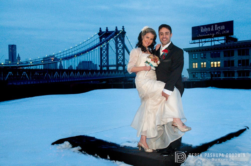 The bride and groom on ReBar rooftop overlooking the Manhattan Bridge