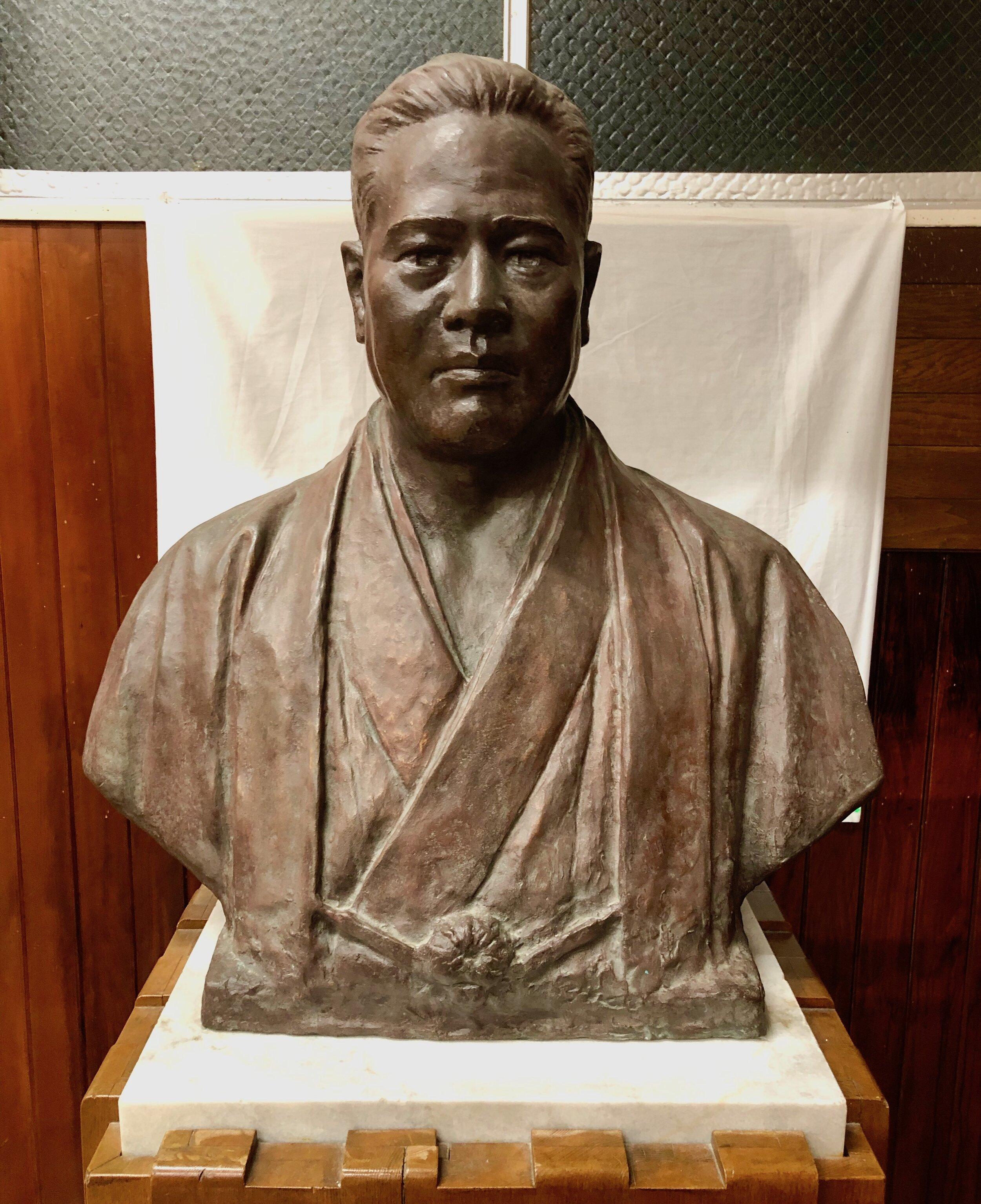 The bronze bust of Chojun Miyagi-sensei inside the Jundokan