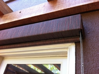 Fabric Covered Metal Fascia mounted over and exterior Solar Roller Shade