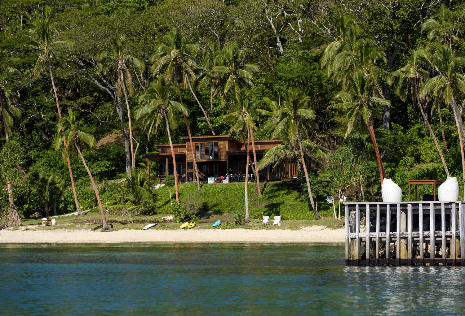 Main Pavilion restaurant and bar, beach and the jetty at The Remote Resort, Fiji Islands
