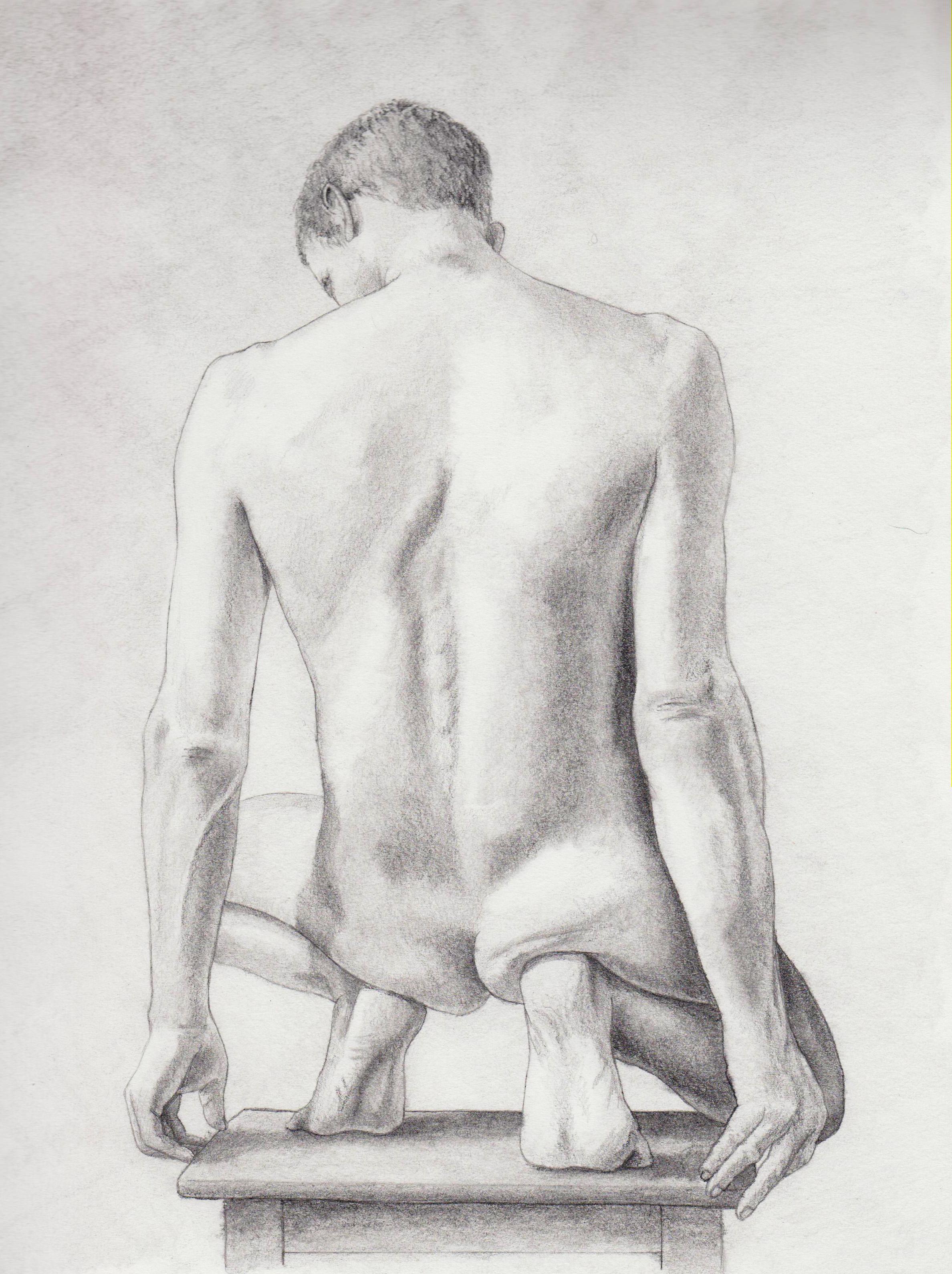 Male figure squatting