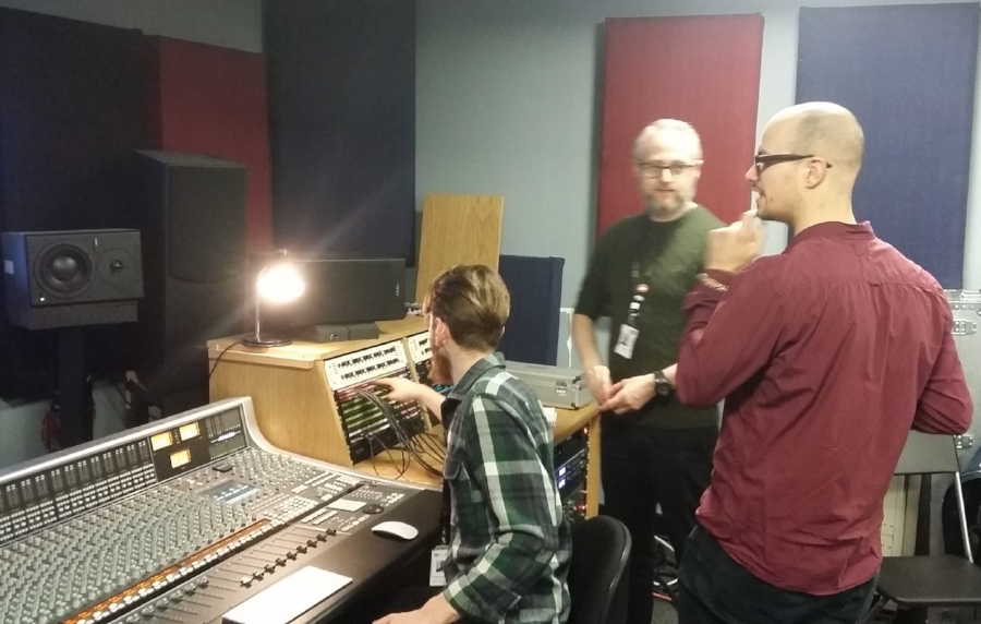 Carry (bass) and (college tutor) James discuss recording technique while Chris (student producer!) connects the patch bay