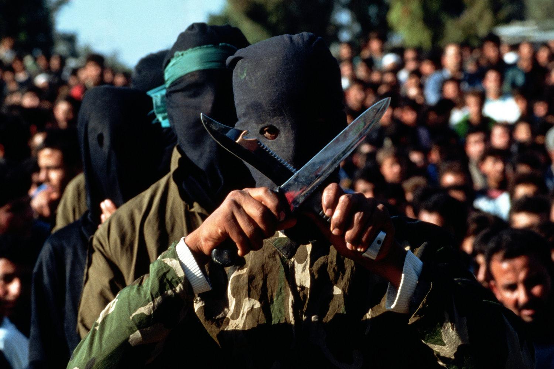 "Hamas militants. Gaza, 1993.<span class=""photo-essays-link""><span class=""separator"">・</span><a href=""/photo-essays"">Photo-essays</a></span>"