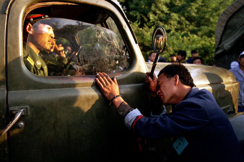 "Tiananmen Square uprising. Beijing, China, 1989.<span class=""photo-essays-link""><span class=""separator"">・</span><a href=""/photo-essays"">Photo-essays</a></span>"