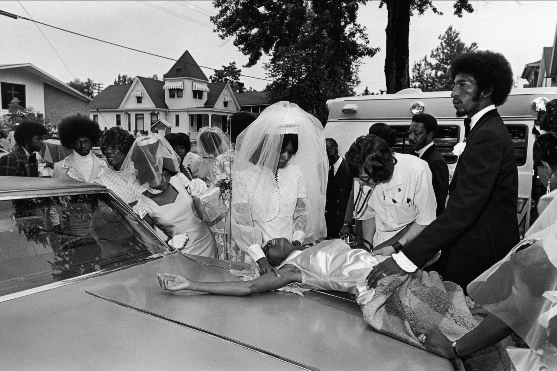 "Fainted bridesmaid. Ft. Wayne, Indiana, 1974.<span class=""photo-essays-link""><span class=""separator"">・</span><a href=""/photo-essays"">Photo-essays</a></span>"