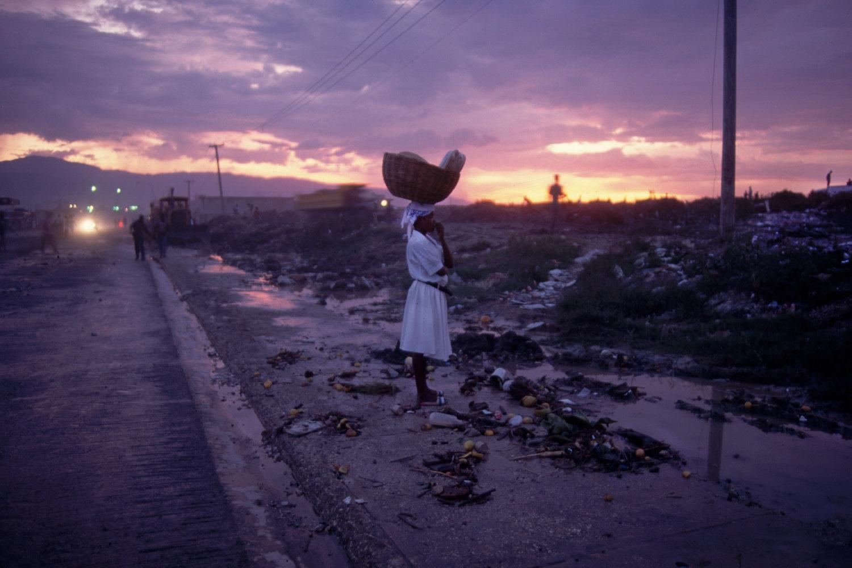 """Cité Soleil, Port-au-Prince, Haiti, 1994<span class=""""photo-essays-link""""><span class=""""separator"""">・</span><a href=""""/photo-essays"""">Photo-essays</a></span>"""