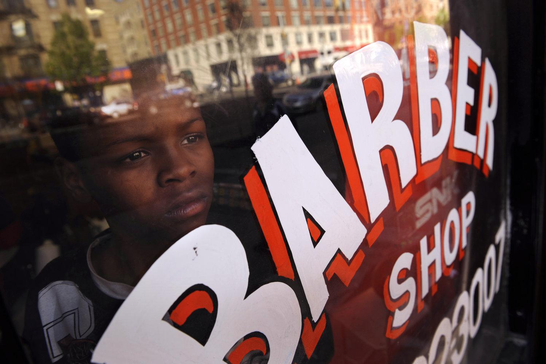 "T.R.Y. Star Barbershop. Harlem, New York, 2010.<span class=""photo-essays-link""><span class=""separator"">・</span><a href=""/photo-essays"">Photo-essays</a></span>"