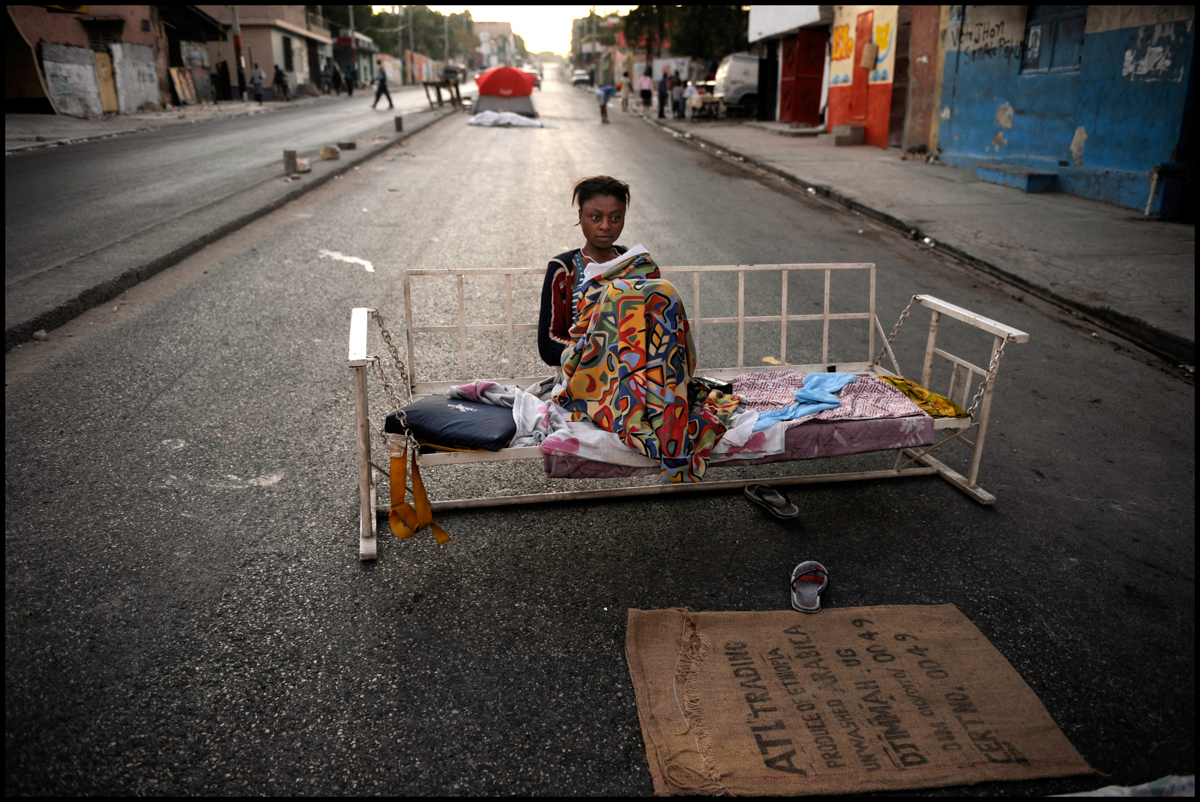 02 Feb 2010, Port-au-Prince, Haiti --- Micheline Merius, 22, homeless since the earthquake, sleeps nightly on the streets of Delmas 10/12.