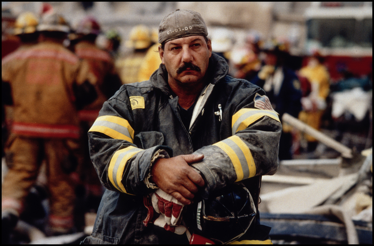 12 Sep 2001, Manhattan, New York City, New York State, USA --- A firefighter rests after a long night of fighting fires and searching for victims in the rubble at Ground Zero