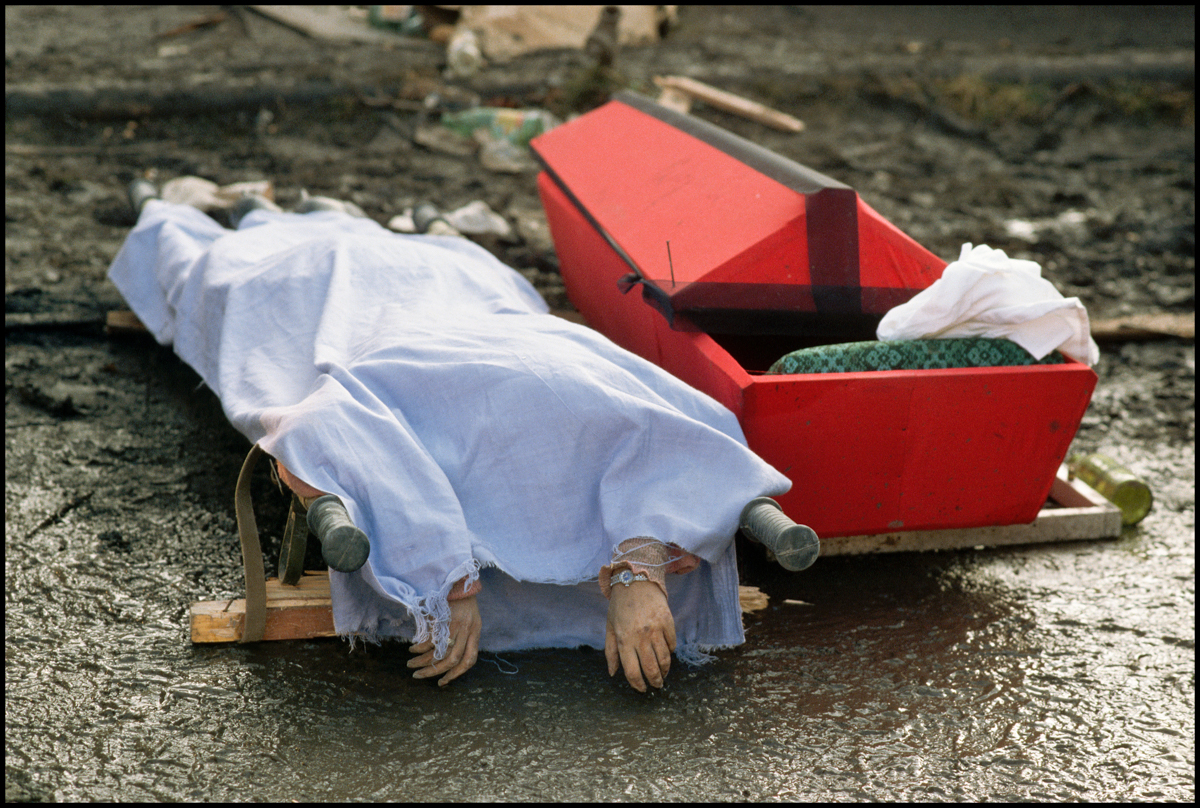 1988, Gyumri, Armenia --- A corpse in Leninakan, Armenia, the victim of an earthquake in 1988.
