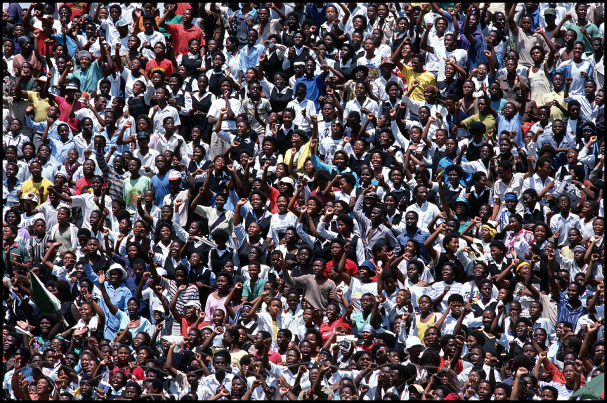 12 Feb 1990, Soweto, South Africa --- Crowds of South Africans rally at a stadium to show their support and happiness for Nelson Mandela, who spoke at the rally, after his release from prison.
